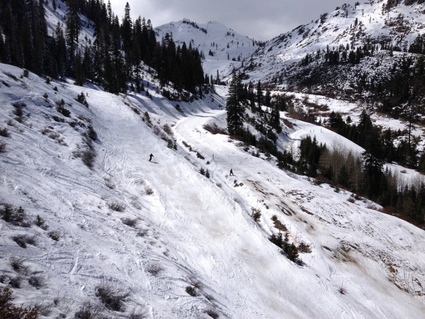 A patroller shovels snow onto Mountain Run at Squaw on Monday. Photo courtesy of SnowBrains.com