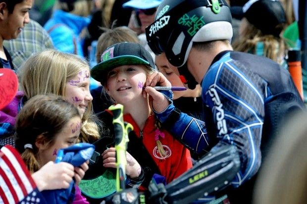 Athletes sign autographs at the US Alpine Championships several years ago. Image via Pinterest